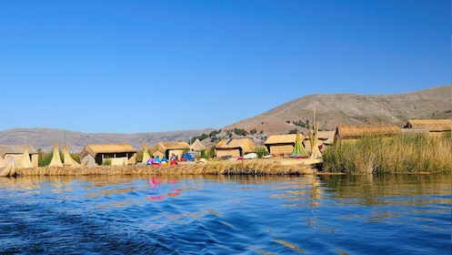 Wide view of the Uro people on their floating island on Lake Titicaca