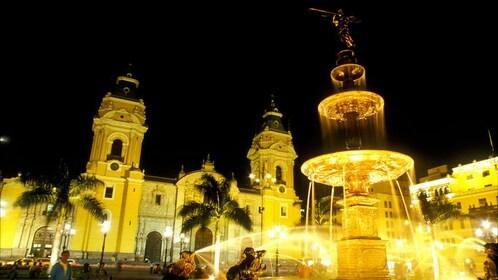 Plaza de Armas lit up at night in Lima Peru