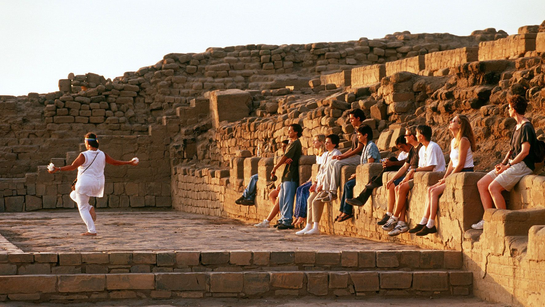 Group spectating traditional rituals at the Pachacamac ruins in Lima