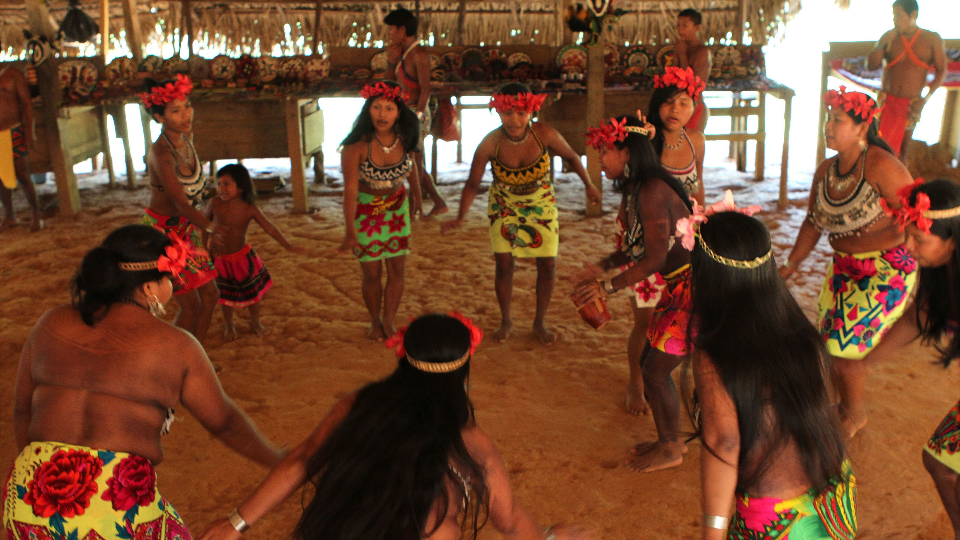 Embera women dressed in colorful traditional clothes performing a dance in Panama