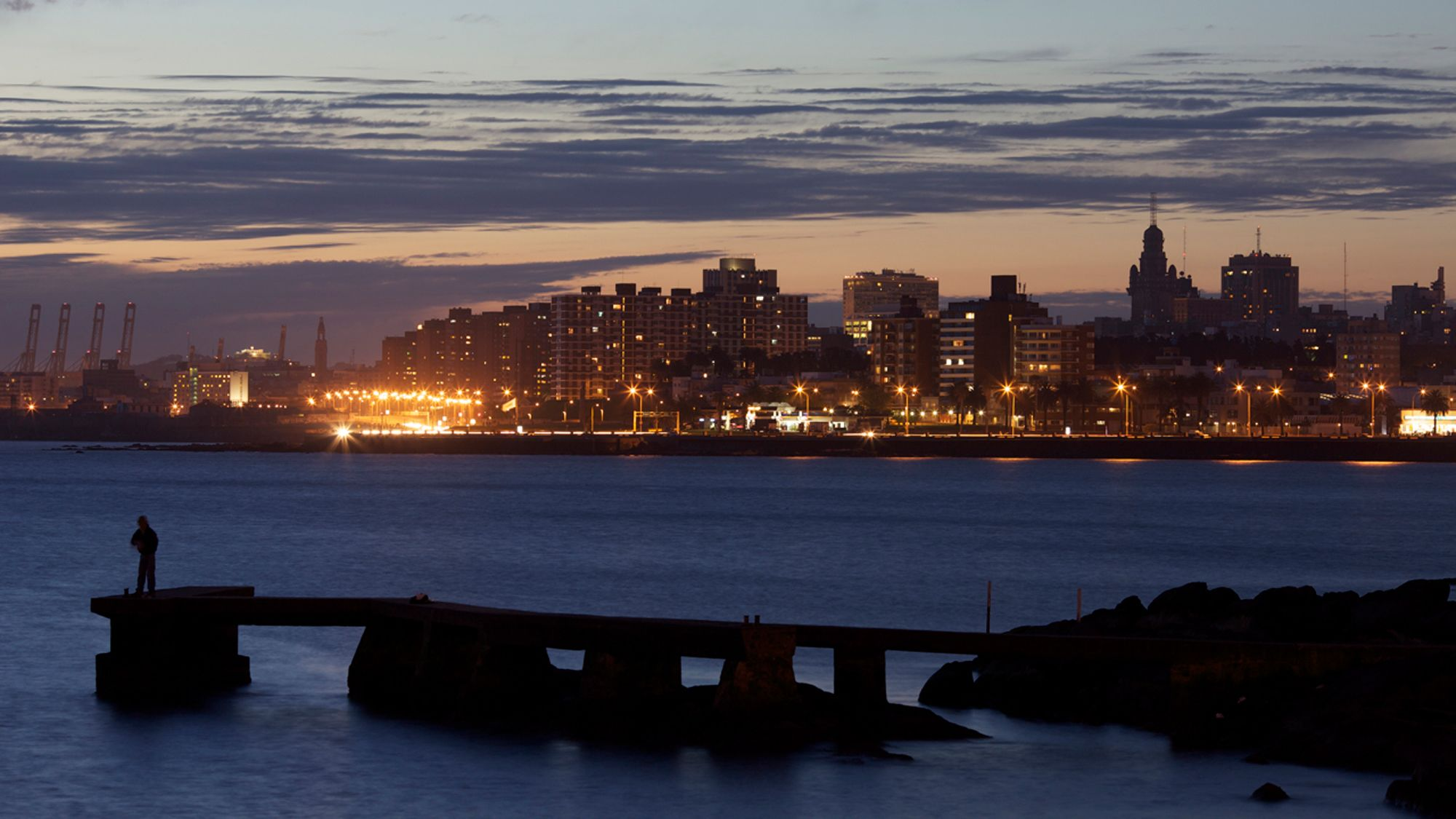 Gorgeous night view of the water and city of Montevideo