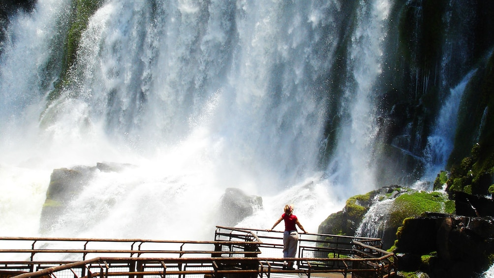 Cargar ítem 1 de 9. Close view of Iguazu Falls in Argentina with someone standing in awe looking at the falls
