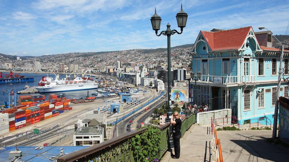 Carregar foto 1 de 7. Woman looking out at the shipyard in Vina del Mar