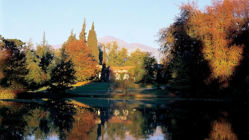 Concha Y Toro Winery with large pond and fall foliage in Santiago