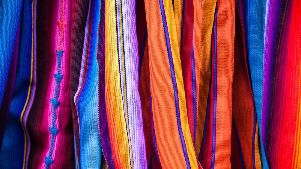 Show item 2 of 6. Colorful woven fabrics at the market in Guanacaste