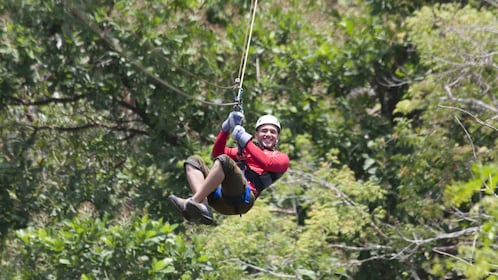 ZIplining man above the trees in Costa Rica