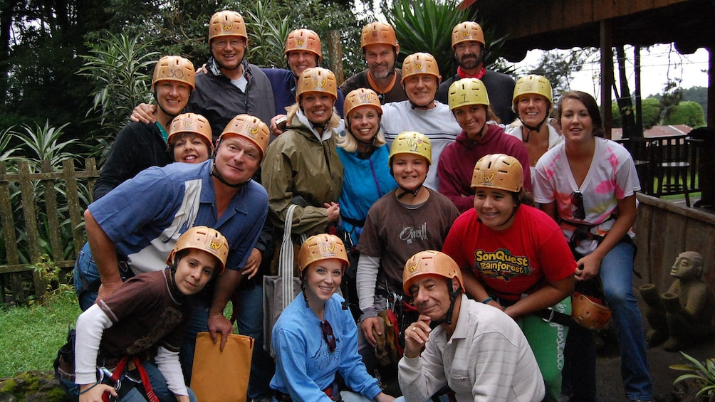 Show item 4 of 9. Helmeted group getting ready to zipline in Costa Rica