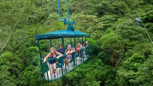 Aerial tram with passengers high above the rainforest in Costa Rica