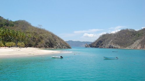 Pristine waters and grassy hills of Tortuga Island in Costa Rica