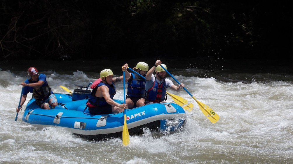Show item 1 of 10. White water rafting group on the rapids of the Pacuare River in Costa Rica