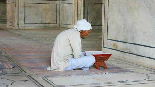 A Man quietly praying in Delhi