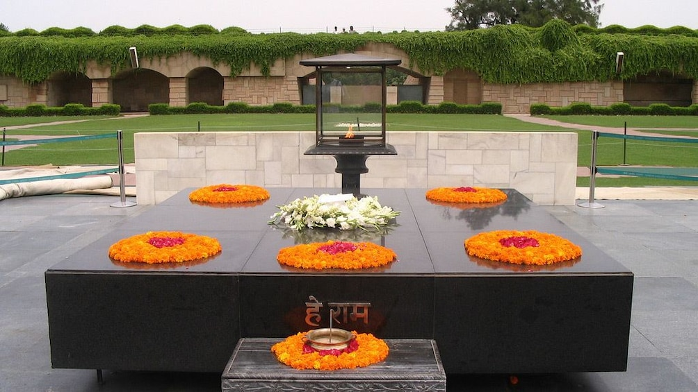 Show item 5 of 9. Colorful flowers adorn a memorial site in Delhi