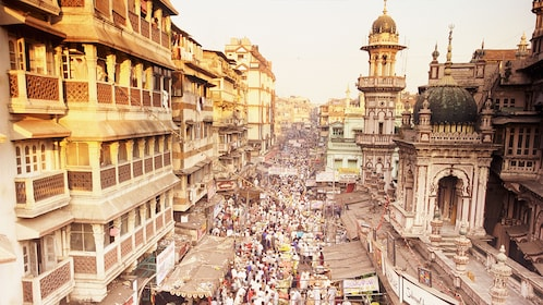 bustling streets surrounded by ancient buildings in Mumbai