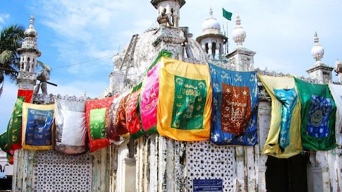 Colorful prayer flags cover a place of worship in Mumbai