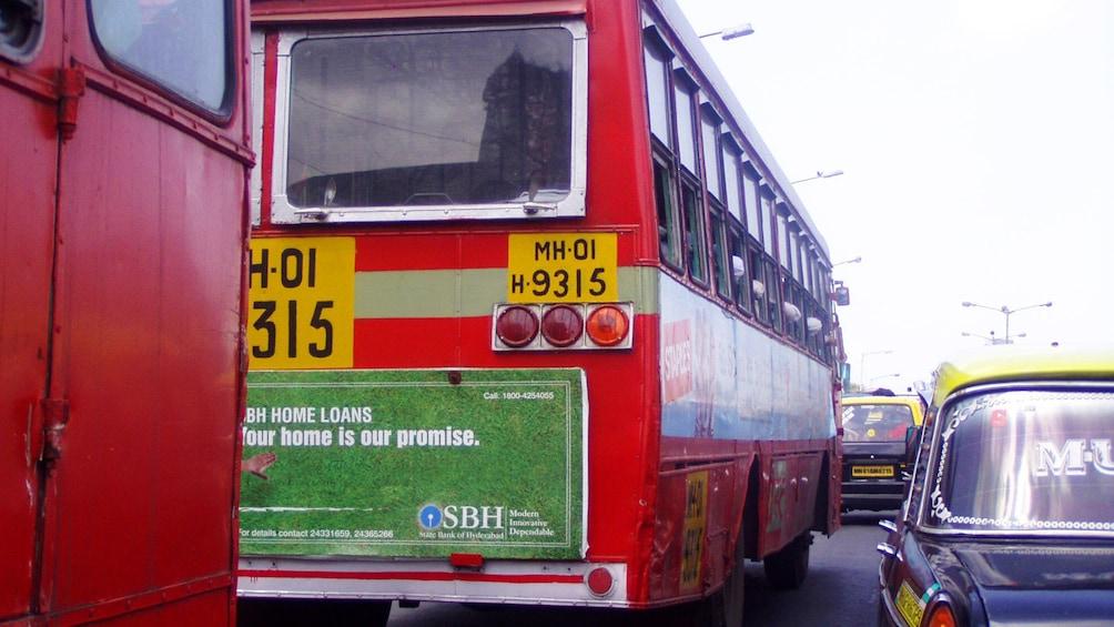 Show item 5 of 6. Buses in traffic in Mumbai