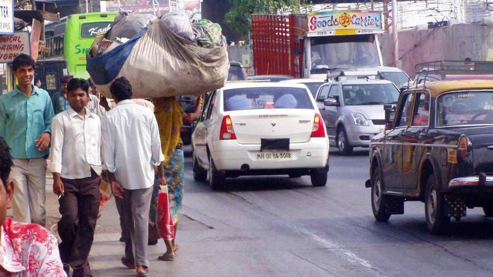 Show item 4 of 6. People walking along busy street in Mumbai