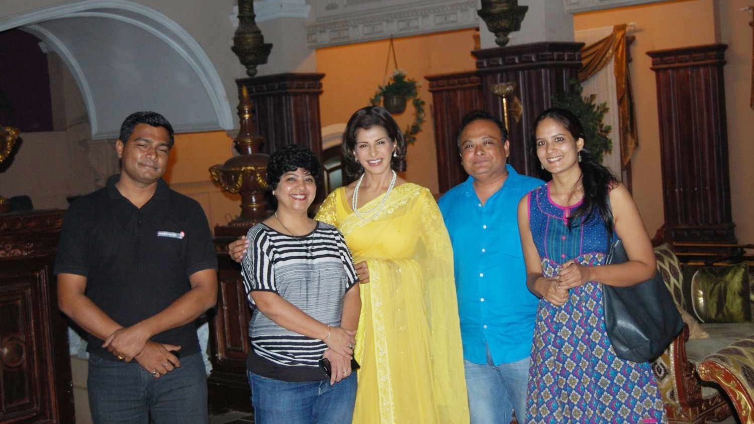 Tour group posing for a photo at a Bollywood studio in Mumbai