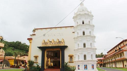 white tower at a temple establishments in Goa