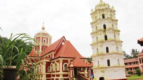white tower next to the Shri Shantadurga Temple in Goa