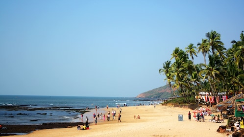 visitors enjoying the sun at the beach in Goa