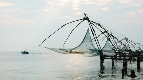 Distinctive sight of the giant Chinese fishing nets above the waters in Kochi