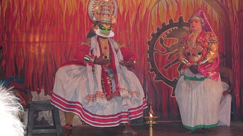 Two performers on stage at the Kathakali Dance Show in Kochi