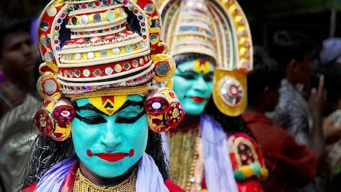 Two performers with their costumes on ready for their performance at the Kathakali Dance Show in Kochi