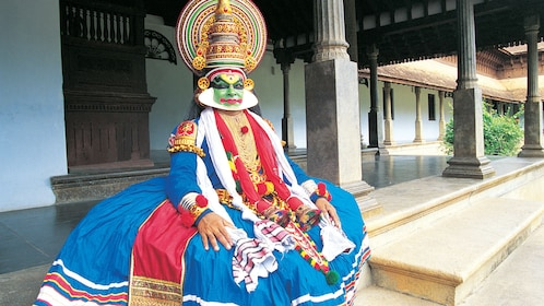 Performer sitting at the Kathakali Dance Show in Kochi