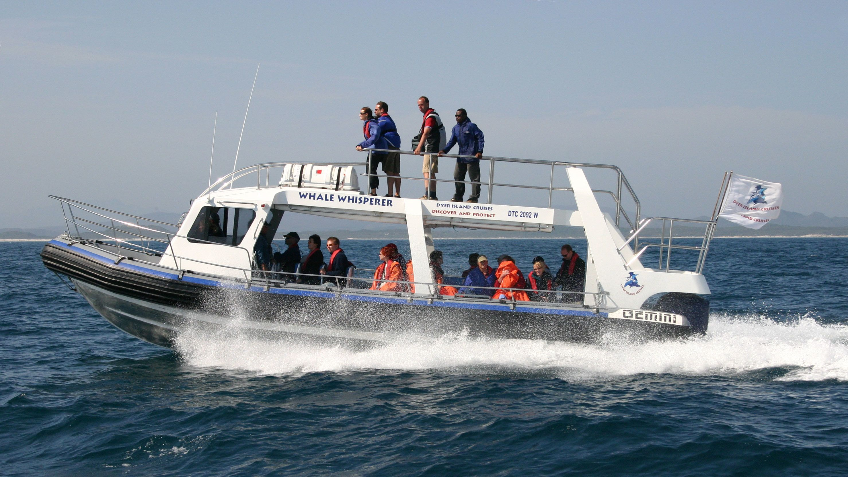 Whale watching boat speeding in the ocean in South Africa