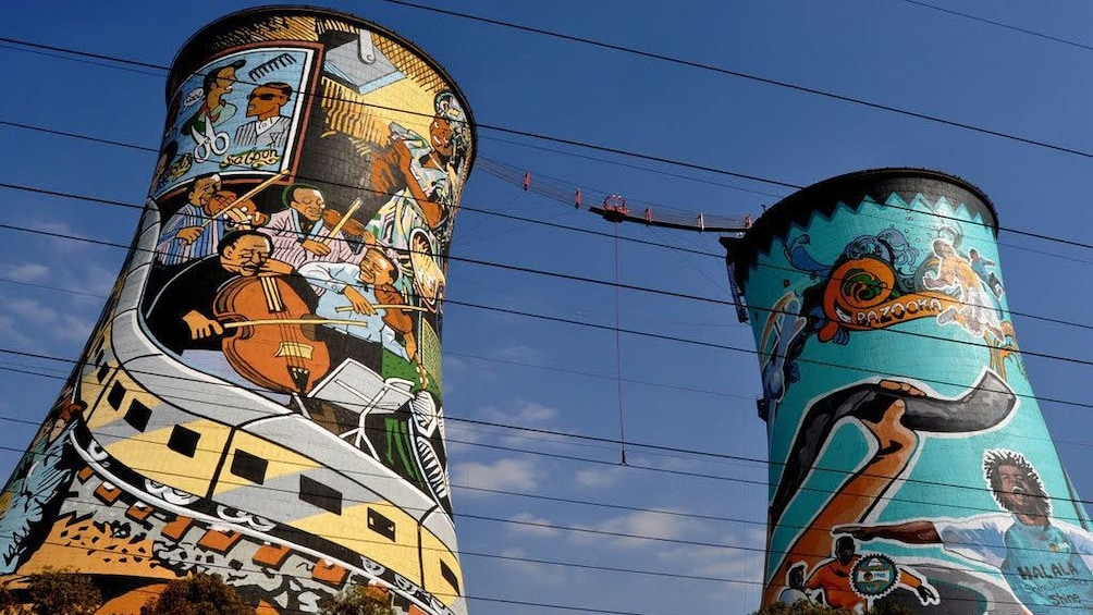 Show item 2 of 9. Two towers with colorful murals in Soweto South Africa