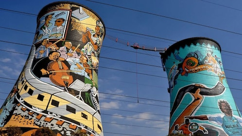Two towers with colorful murals in Soweto South Africa