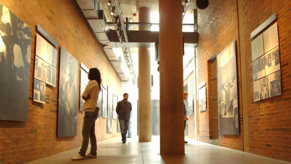 Visitors stroll through Apartheid Museum exhibit