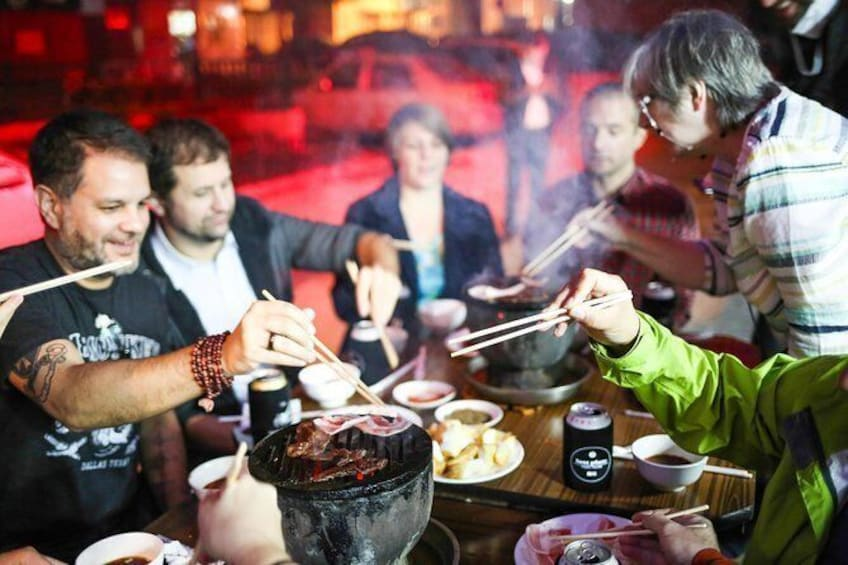 Grill your own meats and veggies at a local Beijing BBQ joint!