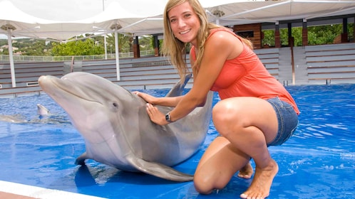 A woman with a dolphin at Marineland