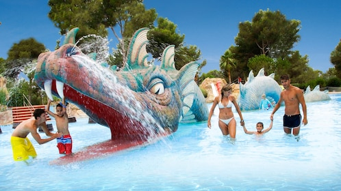 A dragon themed fountain in a pool at Aqualand