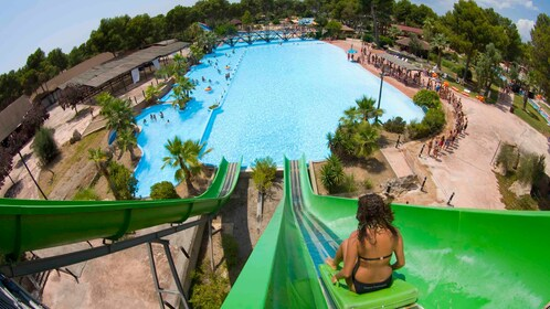 A woman going down a water slide at Aqualand in Mallorca