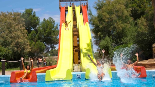 People on waterslides at a water park in Mallorca