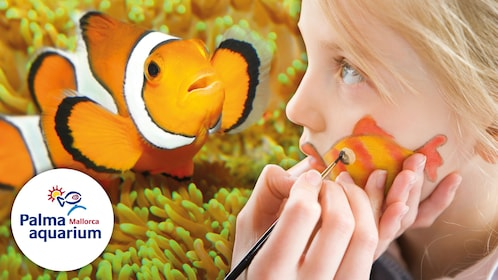 Girl getting a clownfish painted on her face at an aquarium in Mallorca