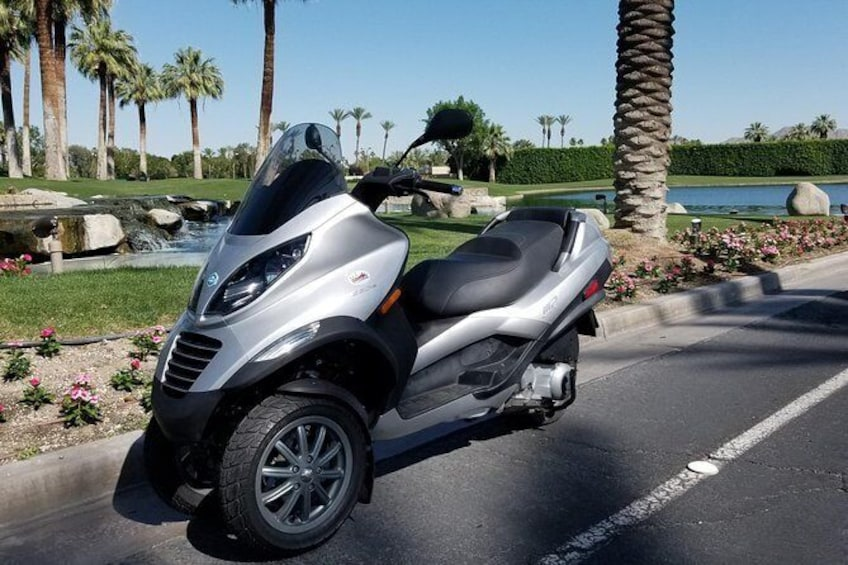 Show item 2 of 15. Modern Piaggio MP3 Luxury Scooter Rentals