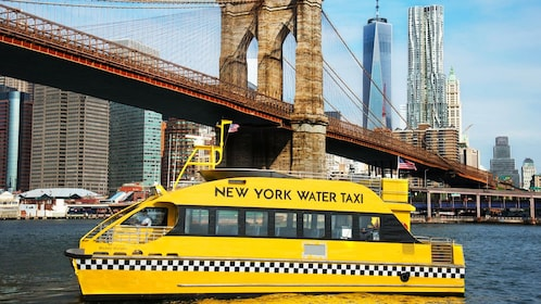 New York Water Taxi going under the Brooklyn Bridge in New York