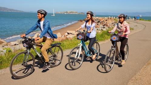 three people riding bikes in San Francisco
