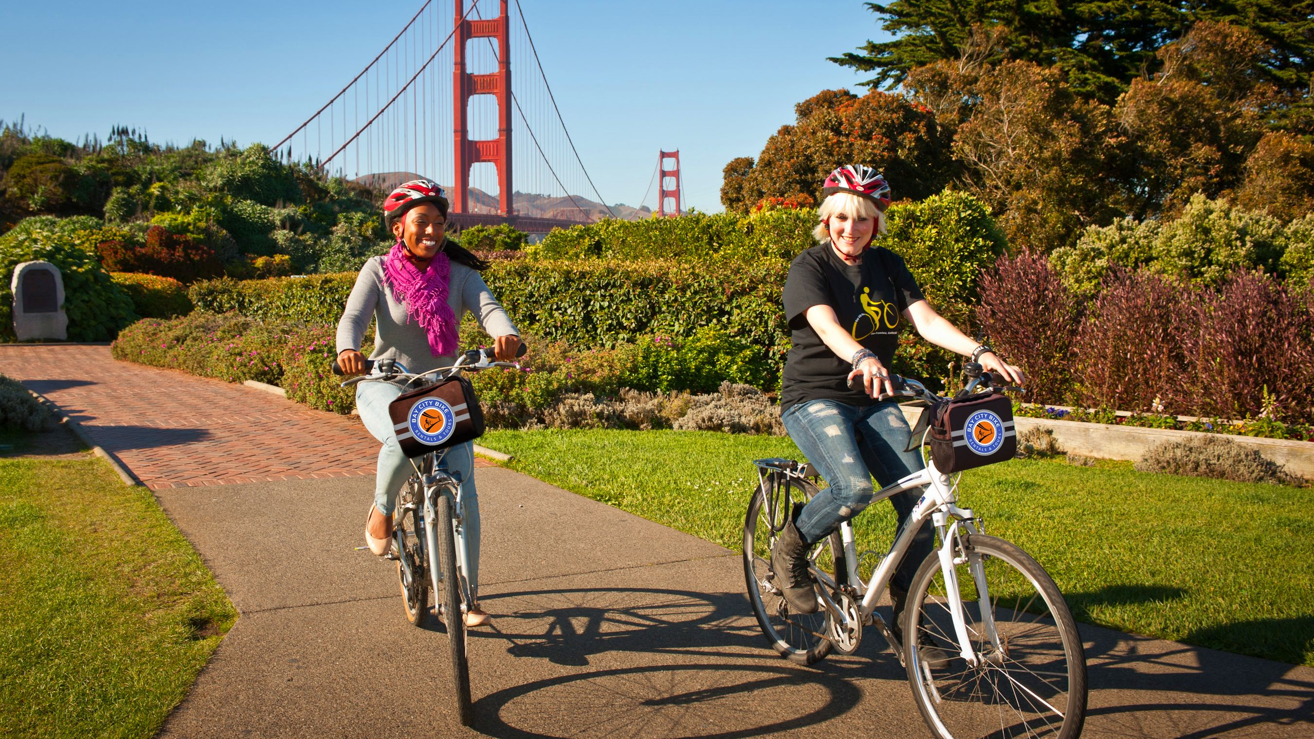 Two people riding bikes in San Francisco
