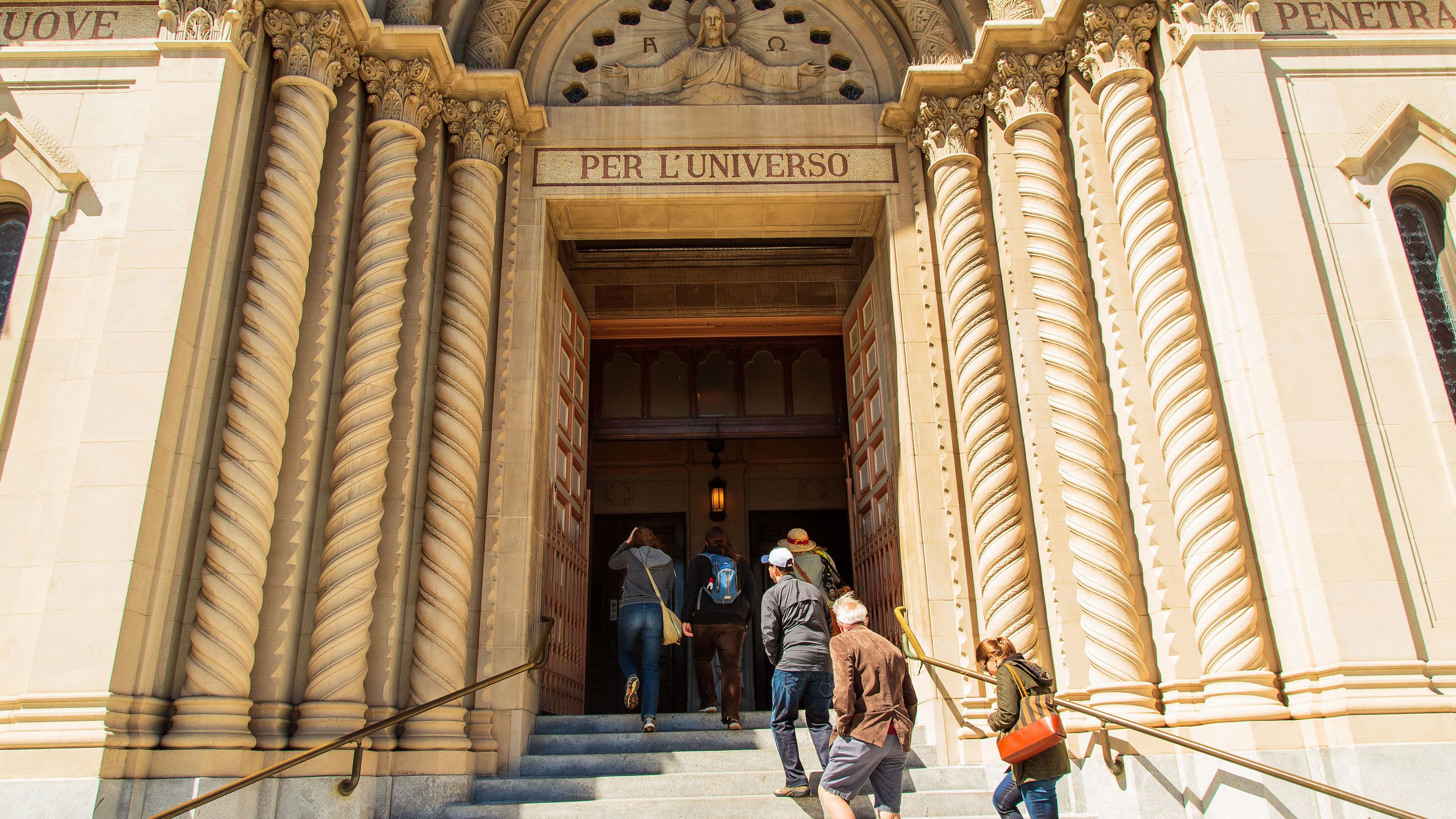 Group at the columned entrance of Per L'Universo church in San Francisco
