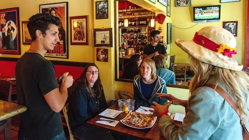 Tour guide with group at a restaurant in San Francisco