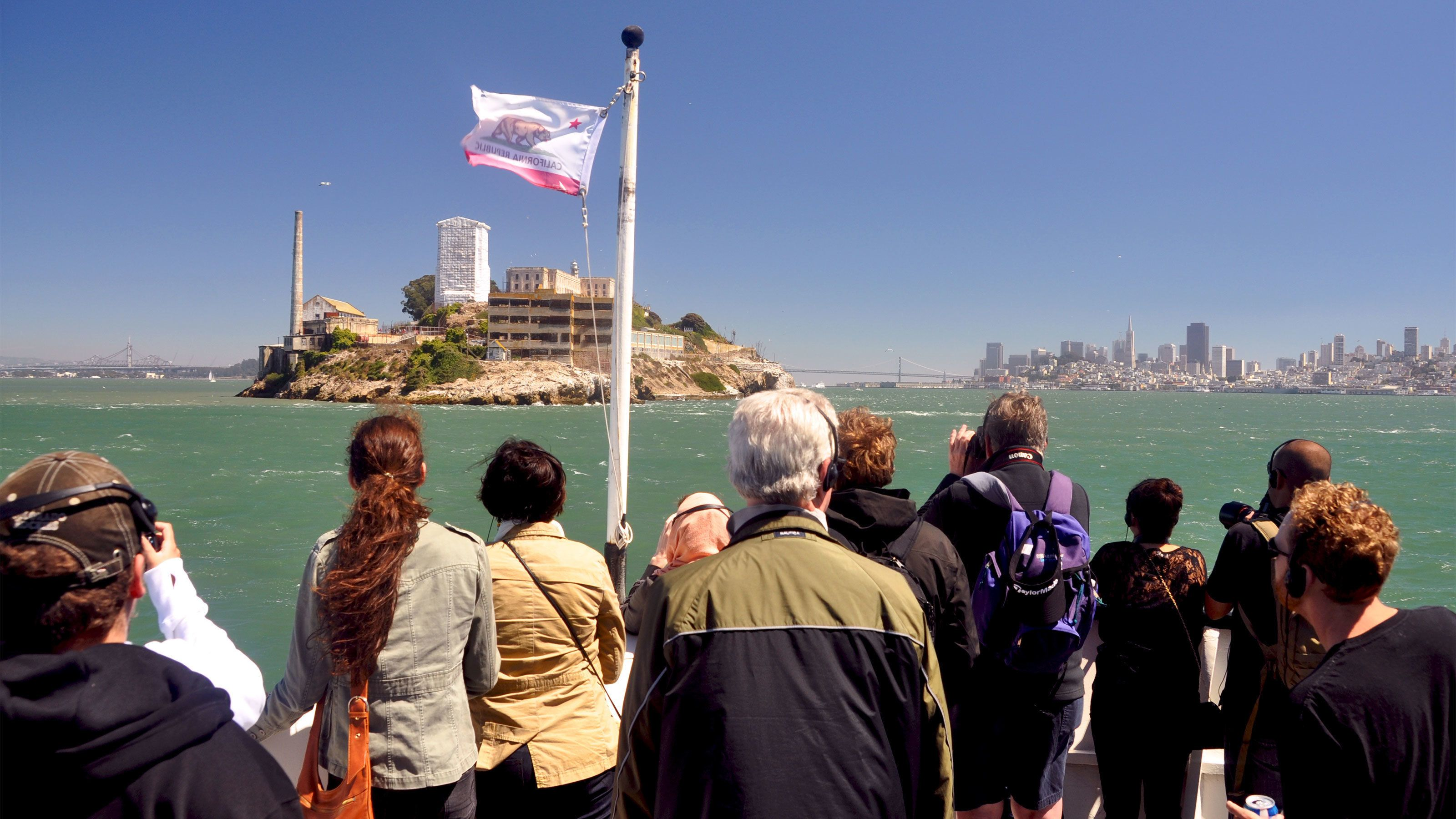 Tour group looking at Alcatraz from a boat in San Francisco