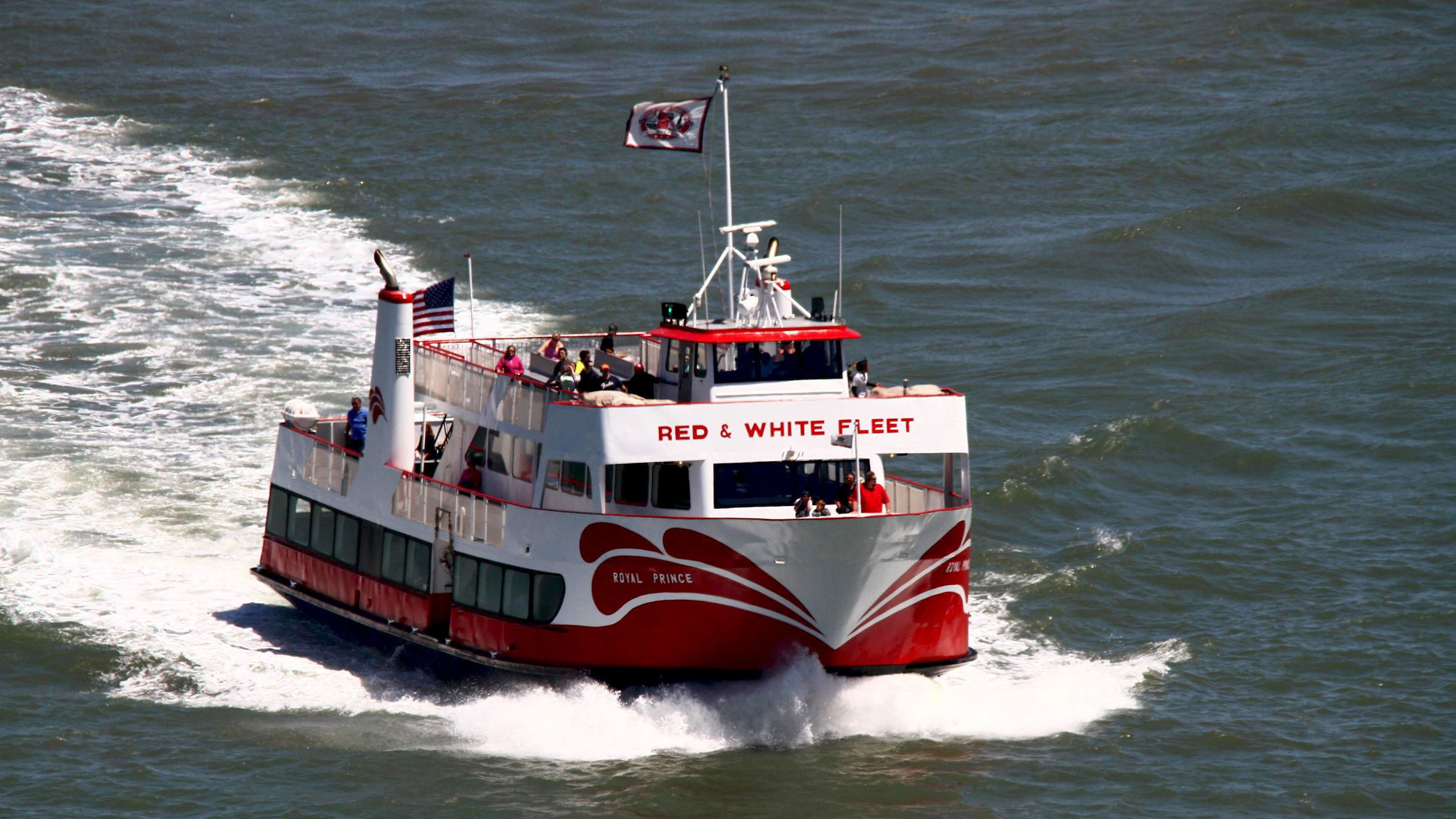 Red and White Fleet tour boat on the water in San Francisco