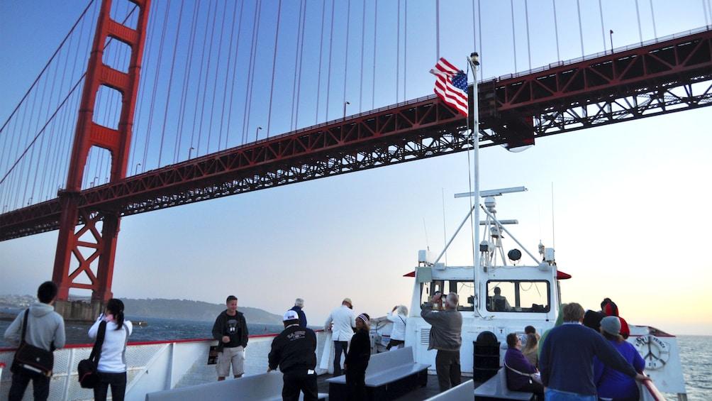 Sightseeing boat going under the Golden Gate Bridge in San Francisco