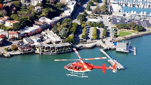 Helicopter over the water near the shoreline in San Francisco