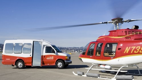 Helicopter landing with shuttle bus in San Francisco