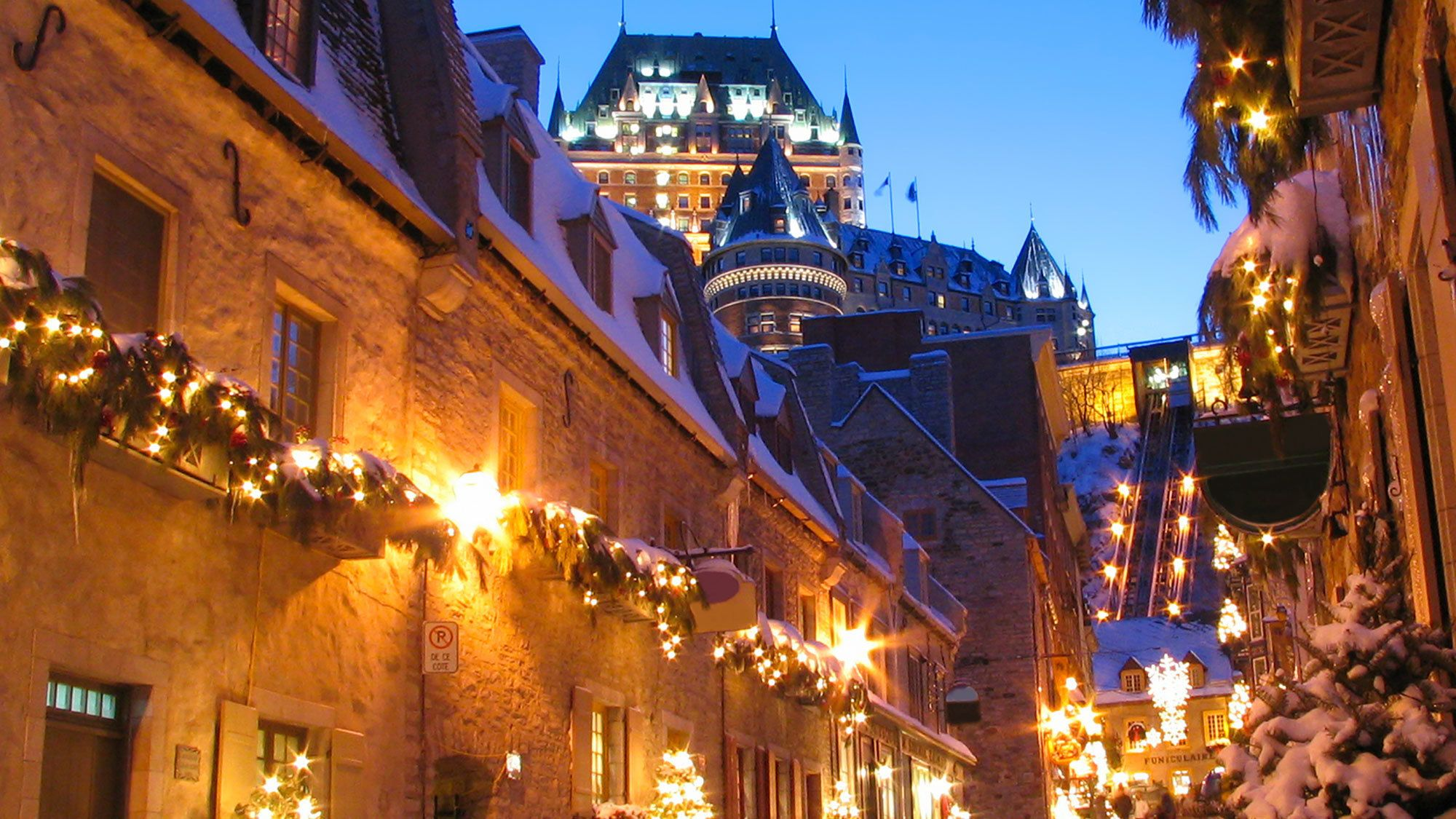 Lighted street at dusk in winter in Quebec City